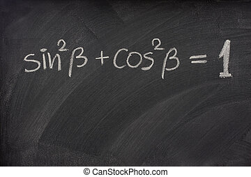 Pythagorean trigonometric identity handwritten with white chalk on a blackboard