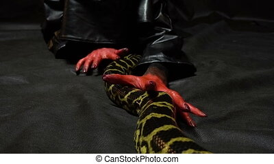 Python and bloody hands - Footage of woman with bloody hands...
