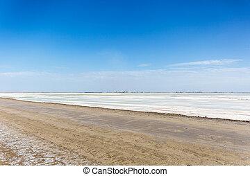 salt lake industrial landscape and dirt road - qarhan salt ...