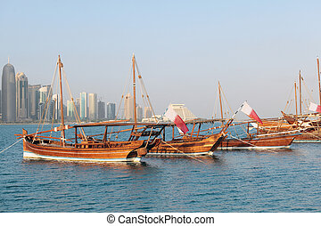 Qatar dhows on show - Traditional sailing dhows lined up in ...