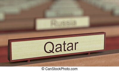 Qatar name sign among different countries plaques at...