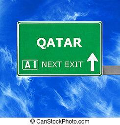 QATAR road sign against clear blue sky