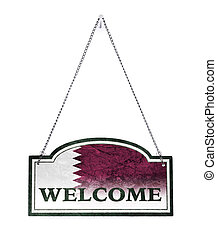 Qatar welcomes you! Old metal sign isolated