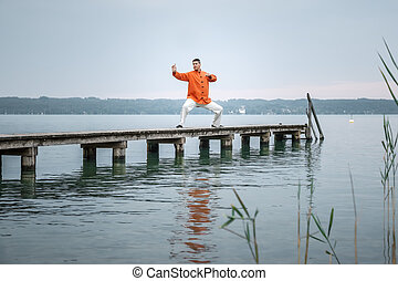 Qi-Gong early morning - A man doing Qi-Gong in the early...