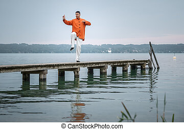 Qi-Gong early morning - A man doing Qi-Gong in the early ...