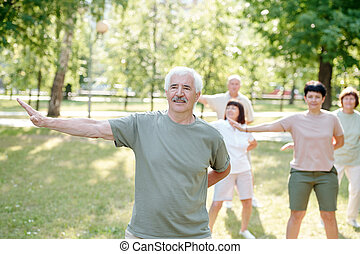 Qigong for relaxation and health - Handsome senior man with ...
