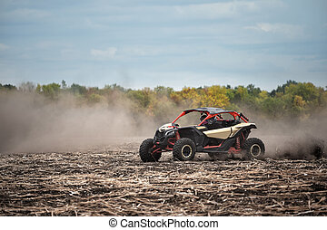 Quad bike in a plowed field