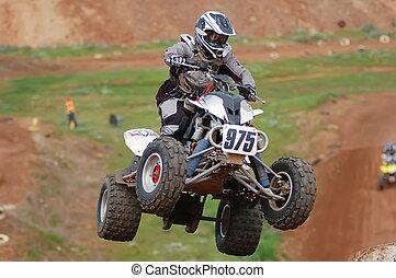 Quad bike racing, airborne into a corner