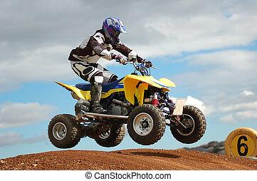 Quad bike racing, Airborne over a jump