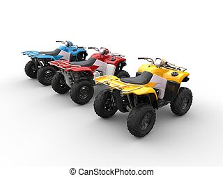 Quad bikes in primary colors - red, blue and yellow - back side view