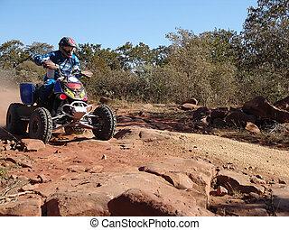 quad motorcycle racing in kalahari desert