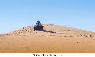 Quad Runs up White Sand Dune Crest Disappears - quad runs up...
