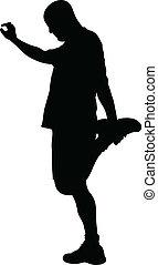 A silhouette of a man doing a quad stretch.