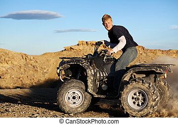 quad - teen driving four wheeler