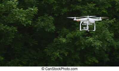 Quadcopter with camera flying in slow motion