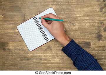 quaderno, mano aperta, scrittura