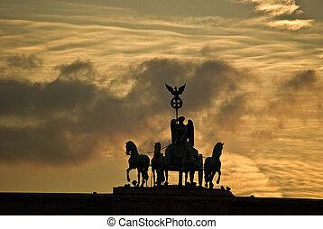quadriga on top of the Brandenburger Tor in Berlin at sunset