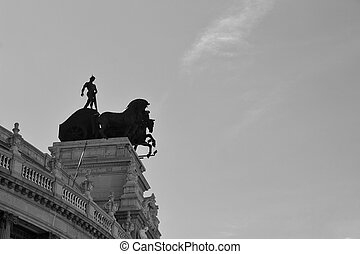 Quadriga statue on the roof of a building in Madrid