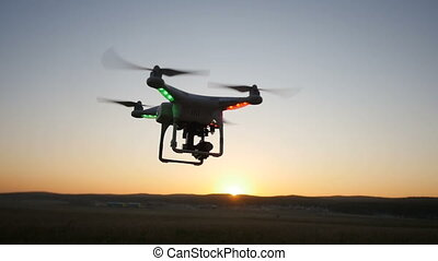 quadrocopter flight at sunset