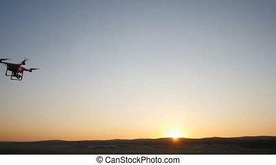 quadrocopter flight at sunset
