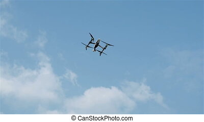 Quadrocopter Flying In The Sky. Modern Guarding Zone From The Air On The Camera.