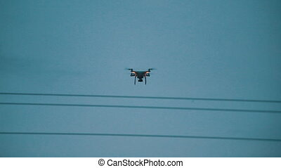 quadrocopter in the sky flying down