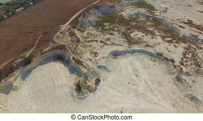 Quadrocopter is flying over a quarry - Quadrocopter flies...