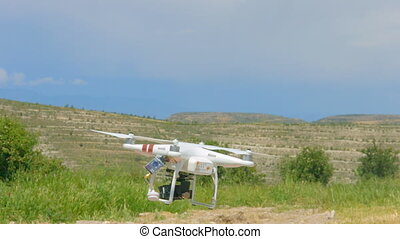 """Quadrocopter landing, modern spy technology for surveillance, drone with camera"""