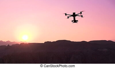 Quadrocopter Over the Canyon - Powerful quadrocopter curled...