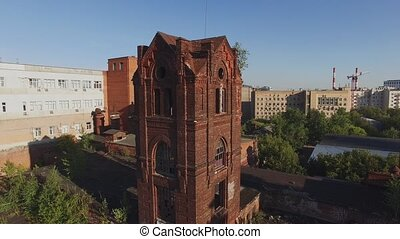 Quadrocopter shoot abandoned chapel on roof of old brick...