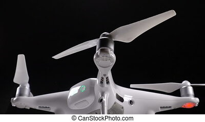 Quadrocopter starts rotating propellers, slow motion