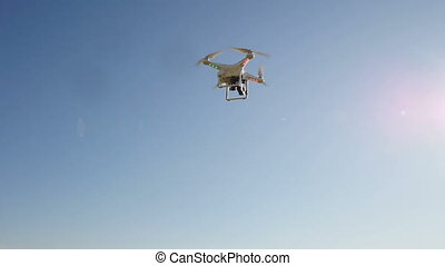 quadrocopters flying in the sky