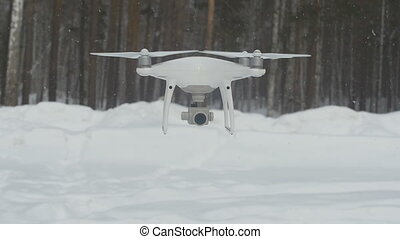 Quadrocopters in the air, the drone's camera is pointed in...