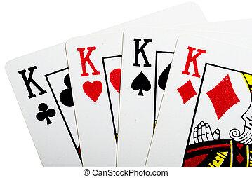 Quads of king for poker closeup