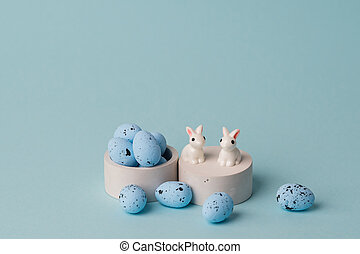 quail blue easter eggs on blue background. Minimal comcept with copy space. spring holidays decor. High quality photo
