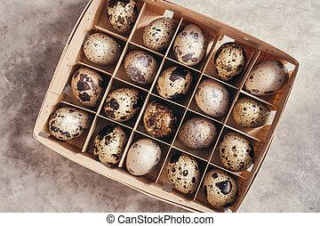 Quail eggs in a wooden box