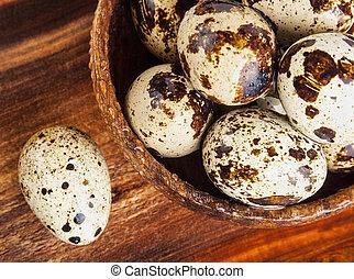 Quail eggs on a wooden table
