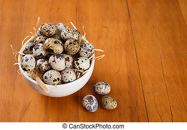 quail eggs on top of a straw background. top view
