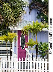 quaint cottage with pink door