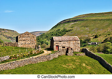 Quaint old stone barns surrounded by dry stone walls...