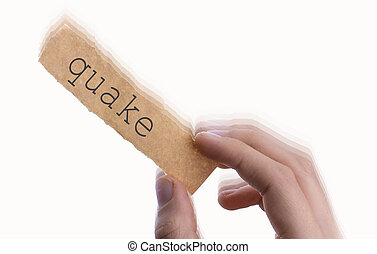 Quake word on torn notepaper in hand