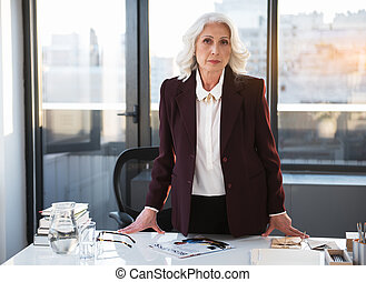 Qualified senior woman is demonstrating professionalism