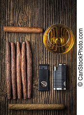 quality cigars with cognac, lighter and cutter