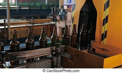 Quality control of glass bottles. Beer brown bottles move...