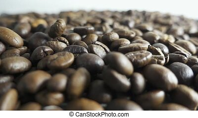 quality of grain roasted coffee to spill in the table , slow...