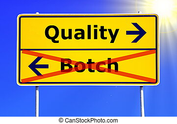 quality or botch business concept with yellow road sign