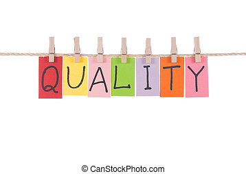 Quality, words hang by wooden peg - Quality, paper words...