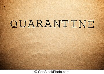 Quarantine word on a brown paper.