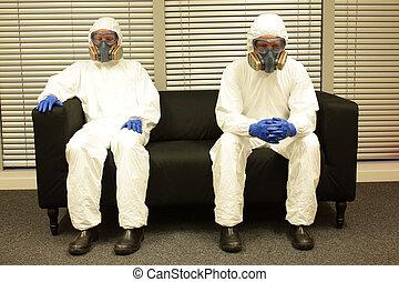 Quarantine. Man in uniforms waiting on the sofa
