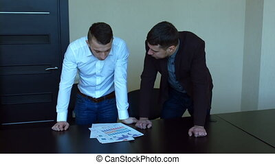 Quarrel businessman screaming. Angry young man in the office,